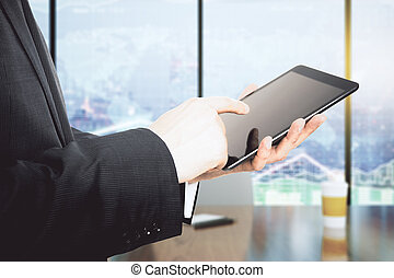 Businessman working with a digital tablet in office