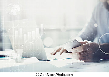 Businessman working with generic design notebook. Holding smartphone in hands. Worldwide connection technology interface