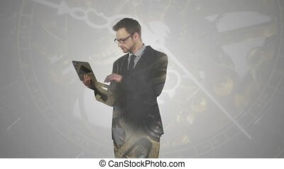 Businessman working with laptop double exposure over clock parts