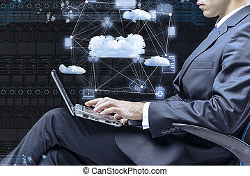 Businessman working with laptop in cloud computing concept