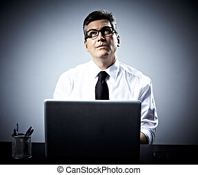 Businessman working with laptop portrait.