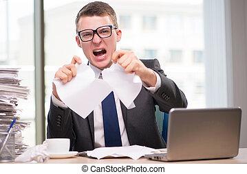 Businessman working with much paperwork