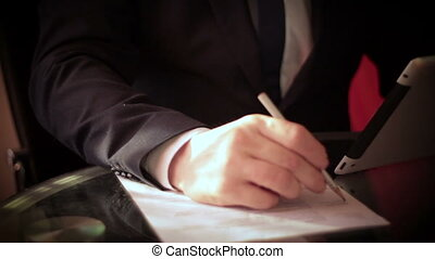Businessman working with tablet and documents