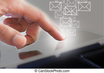 Businessman working with tablet and mail symbol