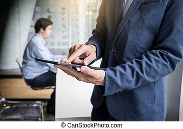 Businessman working with tablet in office, closeup