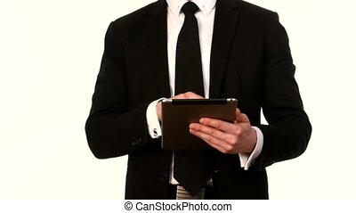 Businessman working with tablet PC on white