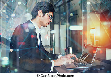 Businessman works at home with a laptop. concept of internet sharing. Double exposure