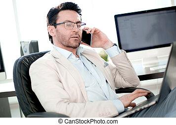 businessman works in a modern office