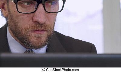 Businessman works on laptop