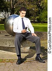businessman writing a text message
