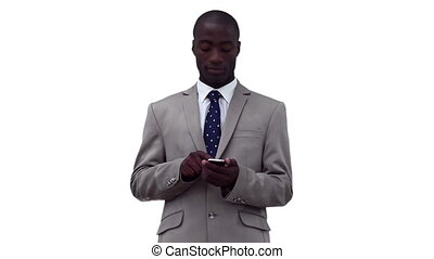 Businessman writing a text message before looking upwards