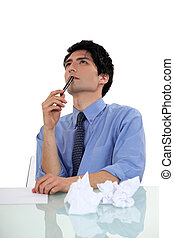 businessman writing and thinking