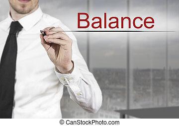 businessman writing balance in the air