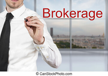 businessman in office writing brokerage in the air