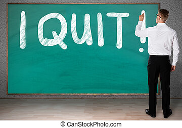 Businessman Writing I Quit On Blackboard