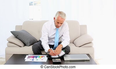 Businessman writing in his diary an