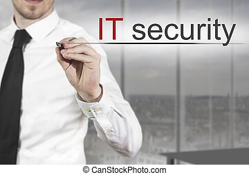 businessman writing it security in office - businessman in...