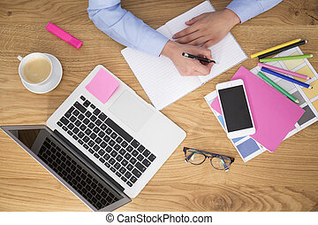 Businessman writing notes at home