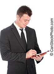 Businessman writing notes on a clipboard