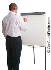 Businessman writing on a flip chart.