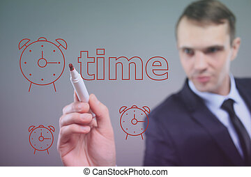 businessman writing on a transparent board - time. painted clock