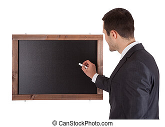 Businessman writing on blackboard