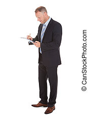 Businessman Writing On Clipboard