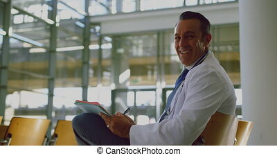 Businessman writing on notepad in a modern office 4k