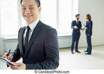 Businessman writing plan