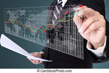 Businessman writing stock graph