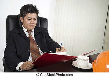Businessman writing the document