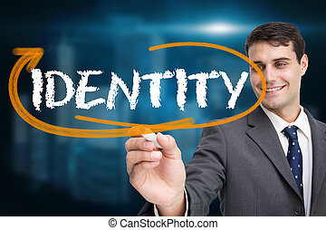 Businessman writing the word identity against shiny ...