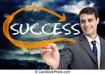 Businessman writing the word success