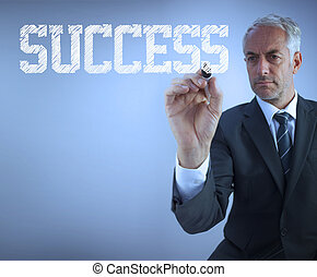 Businessman writing the words success
