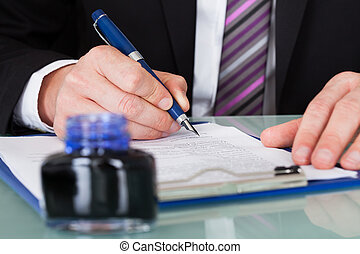 Businessman Writing With Ink Pen