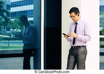 Businessman Writing With Pen On Mobile Phone Display-3 -...