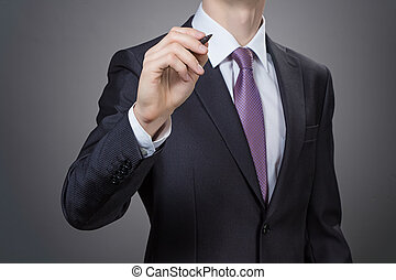 Businessman writting - photo with grey background