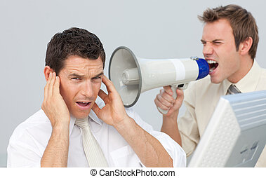 Businessman yelling through a megaphone at his colleague
