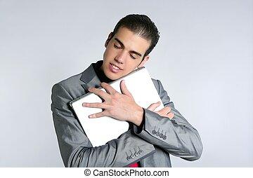 Businessman young embracing computer, hug laptop
