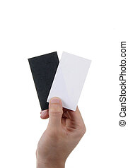 Businessman's hand holding blank and black paper business card