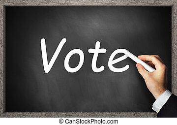 hand writing vote on black chalkboard