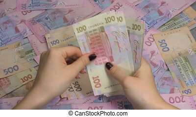 Businessman's hands counting money hryvnia. Counting...