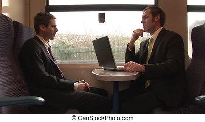 businessmen, за работой, в, поезд