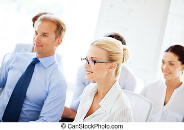 businessmen and businesswomen on conference