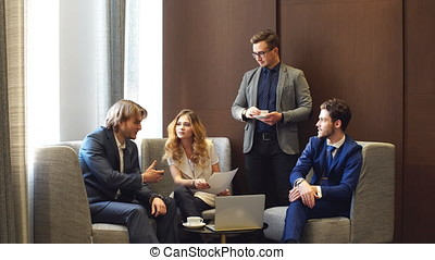 Businessmen And Businesswomen Working Together On A Document.
