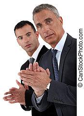Businessmen applauding