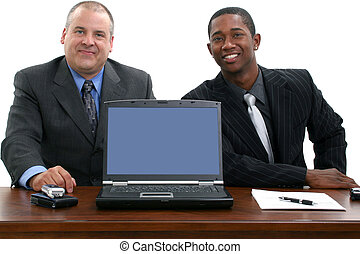 Two businessmen and laptop facing camera. Shot in studio over white.