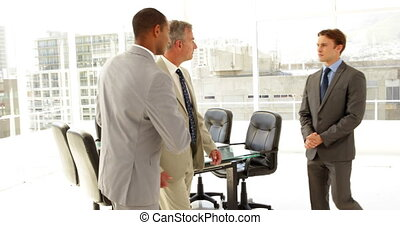 Businessmen being introduced at the office