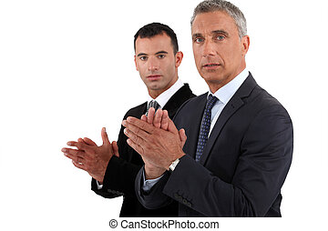 Businessmen clapping their hands