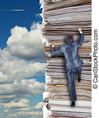 Businessmen climbing up a pile of documents